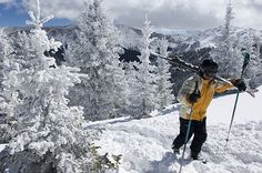 A skier from Santa Fe, New Mexico, hikes through snow-covered trees to the undeveloped ridge above Taos Ski Valley, Taos, New Mexico; Photograph by Kevin Moloney/ Aurora Photos