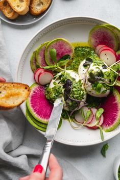 Overhead shot of green goddess pesto burrata being spread on a crostini with watermelon radishes and micro greens garnishing the bowl Light Appetizers, Easter Appetizers, Yummy Appetizers, Fresh Chives, Fresh Herbs, Burrata Recipe, Watermelon Radish, Green Goddess, Seasonal Food