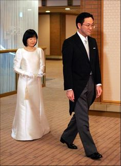 JAPAN | Japan's princess Sayako, the only daughter of Emperor Akihito and Empress Michiko, and her bridegroom Yoshiki Kuroda, a Tokyo government official arrive at the Imperial Hotel in Tokyo for their wedding on November 15. The Princess will leave the Japanese royal family and becomes a commoner after her marriage. | November 15, 2005