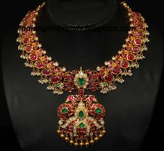 Latest Indian Gold and Diamond Jewellery Designs: Peacock design Ruby Necklace