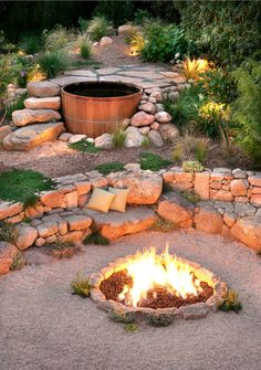 The #firepit, the #stone benches & #stairs, the hot tub - we love everything about this! | Grace Design Associates