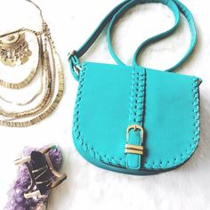 "Teal Leather Crossbody Satchel Gold Hardware Brand new boho style Crossbody satchel with gold hardware. Gorgeous turquoise faux leather satchel with gold hardware and hot pink satin lining. In prefect condition with tags. 21"" drop handle that is adjustable. Please ask if you have any questions. Bundle and Save Bags Crossbody Bags"