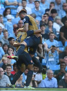 Alexis Sanchez celebrates with Theo Walcott and Olivier Giroud after scoring