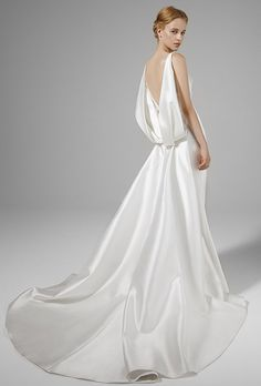 Brides: Peter Langner. V-neckline mermaid dress with draping in the back.