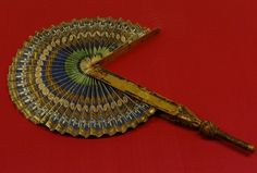 Circular fan with blue and gold wheel Florence, Italy (c14th/15th century)-Florentine Museum of Applied Arts