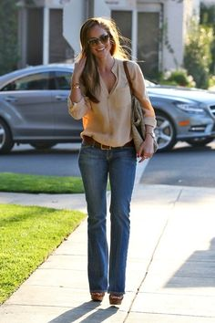 Tan blouse + jeans + bracelets.  Minka Kelly.