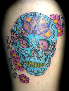 sugar skull - kind of like the way the flowers are around it