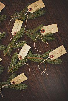 Norway Spruce sprigs are great seasonal escort card holders | Brides.com
