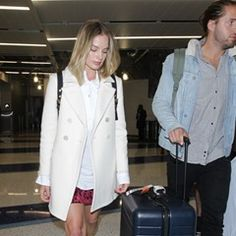 Margot Robbie and husband Tom Ackerley arrive at LAX in Los Angeles