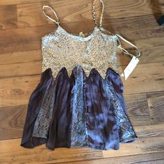 Adorable sequined top! I am seriously obsessed with this top and wish it was my size!! This is a great party top and is so fun with the sheer, dark purple bottom. Plus the braided straps add such a gorgeous detail! Brand new, tags on! BKE Tops Tank Tops
