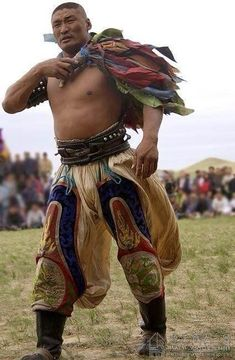 mongolian wrestler wears traditional wide trousers. magnificent male character