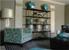 gray & teal decor, open shelves, square chair, gray rug, clear lamp