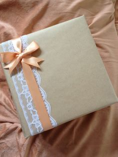 Brown paper lace and ribbon gift wrapped book
