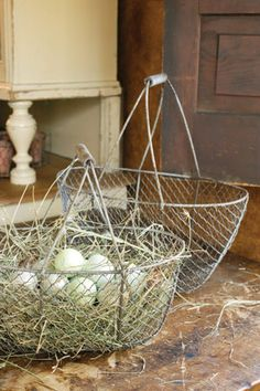 Whether you're collecting eggs from the coop, vegetables from the garden or keeping yarn organized, these vintage style Wire Gathering Baskets help get the job done. The antiqued chicken wire design and old-fashioned wood handle make this set of two sturdy, reliable and very charming