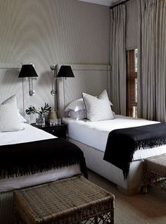 Masculine Guest Bedroom, with Twin Beds and Fabric Upholstered walls that match the Drapes.