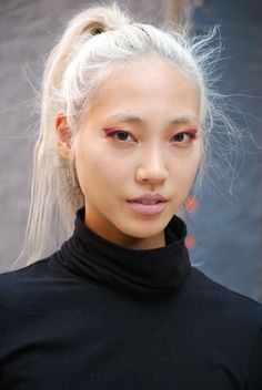High ponytail with flyaways + turtle neck + Asian beauty