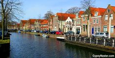 A canal in Hoorn, Holland, The Netherlands.  The epitome of picturesque and quaint!
