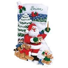 Santa teaches the forest how to sing in this Feltmas stocking.    Google Image Result for http://img4.wfrcdn.com/lf/49/hash/18363/5911679/1/Janlynn-Sing-Along-With-Santa-Felt-Stocking-Cross-Stitch.jpg