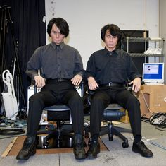 TWINS?  Professor Hiroshi Ishiguro (right) sits next to the Geminoid HI-2 robot, a tele-operated robot that looks exactly like himself in Kyoto, Japan. Ishiguro is director of the Intelligent Robotics Laboratory at Osaka University.