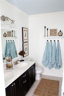 Accent color for black and white bathroom-love how they have hung the towels and all the same colour-more of a statement!