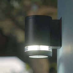 A great example of a modern exterior wall light.and its LED Outdoor Solar Wall Lights, Outdoor Wall Lamps, Patio Lighting, Solar Lights, Outdoor Walls, Exterior Wall Light, Exterior Lighting, Up Down Wall Light, Contemporary Wall Lights