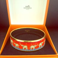 Gorgeous authentic Hermes enamel bracelet Beautiful and rare to find Hermes elephant bracelet. Made in Austria + F. Enamel, gold plated and palladium rims. Hermes size 70 (hand circumference equal or less than 8.6 inch). Width: 0,7 inch, Diameter: 2,75 inch. Bracelet's In perfect condition! Original box has  scratches on its top and the sides ( pic4) Hermes Jewelry Bracelets