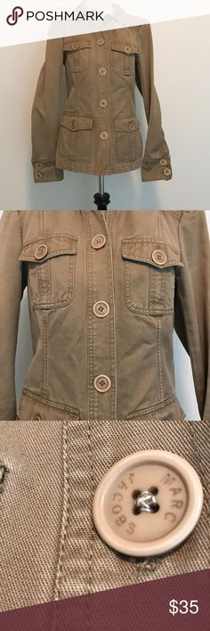 """Marc Jacobs Khaki military jacket Really nice Marc Jacobs Khaki jacket . In great condition with only a slight ( looks to be 2 pen dots) on left sleeve( lady picture shown) . Good either try to get Put( I haven't) or roll sleeves to hide. It's not very noticeable while wearing but should be noted. Other than that , no other stains, tears. Buttons all have """"Marc Jacobs """" inscribed on all. Marc Jacobs Jackets & Coats Utility Jackets"""