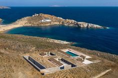 Greek studio Mold Architects has completed a house on the island of Serifos that is partially submerged into a rocky hillside and features glazed openings that look straight out to sea. Carlo Scarpa, Cabinet D Architecture, Villa, Concrete Steps, Exposed Concrete, Mediterranean Sea, Dezeen, Construction, How To Level Ground