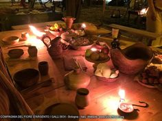 Feast Table with oil lamps. Image From Compagina Del Fiore D'Argento / Galli Boii - Blongna - Italy
