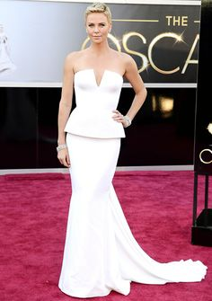 Charlize Theron The Mad Max: Fury Road star rocked a white Dior Haute Couture dress and Harry Winston jewels.  #Oscars 2013 Red Carpet.