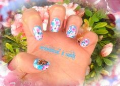 butterfly on spring flowered nails