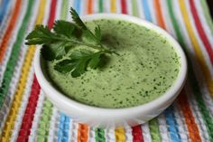 Jalapeno Tree's Green Sauce: 1 avacado,    3 tomatillos,    1 green pepper (bell, anaheim, banana, etc),    1-2 jalapenos to taste,    2 cloves fresh garlic,    1/2 bunch fresh cilantro,    1 Tablespoon Salt,    8 oz fat free sour cream.  Blend everything together.