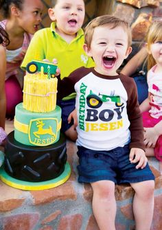 Creative John Deere Themed Party for a boys birthday party with hay bale treats, tire donuts, a tractor piñata, bandana inspired printables and more ideas!