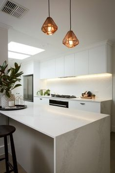 White on white kitchen. Marble looking benchtops. (Caesarstone® benchtop in Calacatta Nuvo with 20mm edge).