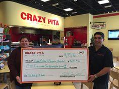 #CrazyPita presents a check to the St. Jude Children's Hospital