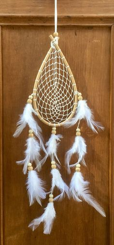 Ratan teardrop macrame dreamcatcher with feathers - handmade in Thailand.