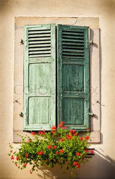 'Rustic window with wooden shutters'