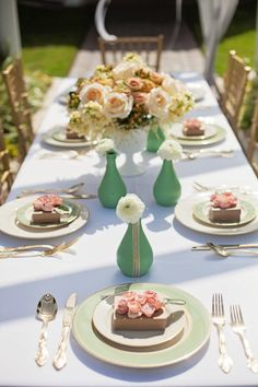 Love the flower arrangements wth the little vases scattered. Antebellum Bridal Tea | nicole ryan photography