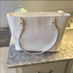White Michael Kors Bag This white patent leather Michael Kors bag has only been worn a few times. It's very clean with no wear. Michael Kors Bags Shoulder Bags