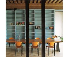 Prouve chairs, black beams, seafoam bookcases....