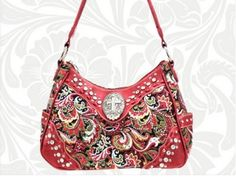 Genuine leather trim bag by Montana West features red paisley fabric adorned with clear rhinestone crystals, trimmed with rhinestones and offset by a rhinestone cross. Multiple inside compartments, one strap, back pocket.