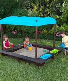 Bitty builders have a blast in this superior sandbox that includes two plastic bins, two covered storage compartments and a roomy play area. Complete with a weather-resistant canopy and liner and constructed from durable wood that ensures longevity, this imagination box invites creative kids to play, explore and build. Includes sandbox, mesh cover, bottom liner, canopy, two plastic bins and ... by stacy