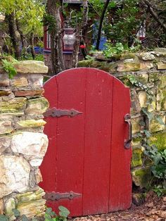Red Garden Gate with Stone Fence