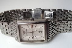 ON AUCTION ON WEDNESDAY 12 AUGUST FROM 8pm.....EMPORIO ARMANI AR-0138 SWISS MADE STAINLESS STEEL 50M QUARTZ CALENDAR WATCH