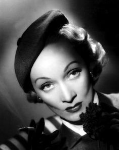 Marlene Dietrich. We hailed the same cab outside a theater in London one night. What could I do? It was raining. I let her take the cab. I even held the door for her. She was wearing pink and looked WUNDERBAR!