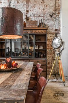 Masculine industrial style living with copper pendant lights, exposed brick walls and timber flooring.  For similar pins please follow me at - https://www.pinterest.com/annelouise1959/loft-and-industrial-style-living/