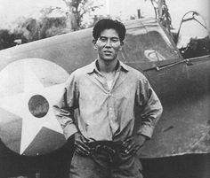 Ensign Junichi Sasai (1918-1942), commanding the Tainan Zero fighter group, Lae. Supervisor of the Saburo Sakai, 64-victory ace, himself an ace, standing in front of the captured P-40, similar to the one he shot down. KIA while Saburo was in the hospital in Japan but kept the special tiger belt buckle that Sasai gave him until his own death in 2000.
