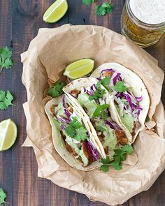 Nothin' says summer like these Blackened Fish Tacos with a delicious Greek Yogurt Avocado Sauce!