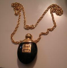 Signed Givenchy Bakelite Perfume Bottle Necklace Haute Couture. $249.00, via Etsy.