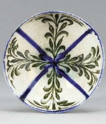 A KASHAN BLUE BLACK AND WHITE POTTERY BOWL